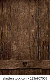 Empty background of old vertical wood and table ornament with a small heart