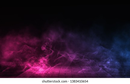 Empty background scene. Dark reflection of the street on the wet asphalt. Rays of neon light in the dark, neon figures, smoke. Night view of the street, the city. Abstract dark background.