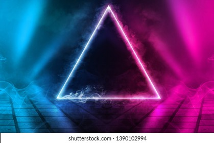 Empty background scene. Dark street, a reflection of blue and pink neon light on wet pavement. Neon triangle in the center. Rays of light in the dark, smoke. Abstract dark background.