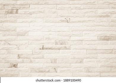 Empty Background of wide cream brick wall texture.