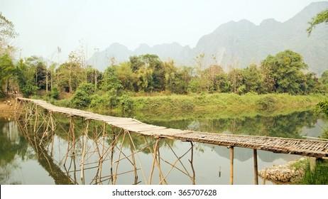 empty bamboo bridge on limestone mountain background
