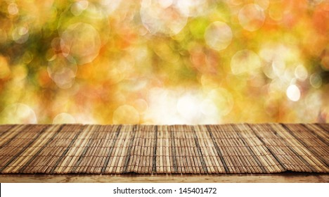 Empty bamboo table for product display montages - autumn theme