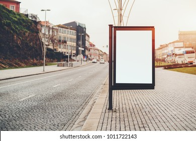 Empty banner mock-up on city sidewalk; white placeholder stand in urban settings of European town; information blank billboard template on street with copy space place for advertising or text message