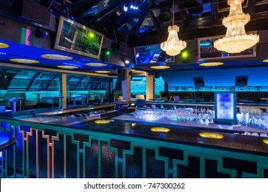 Empty bar counter in discotheque by night