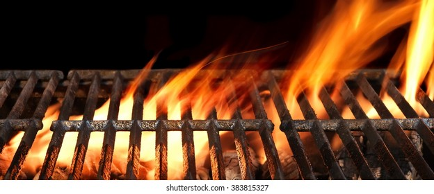 Empty Barbecue Flaming Charcoal Grill With Bright Flames Of Fire Isolated On The Black Background, Close Up, Copy Space, Front View.