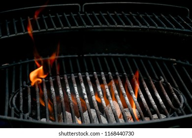 Empty  barbecue grills two step with  flaming charcoal by coconut product and open fire,  a device for cook food as meat, seafood, chicken apply heat from below. Concept grilling in summer party.