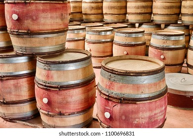 Empty barrels of wine are stacked up in a winery cellar waiting to be used after the next harvest.
