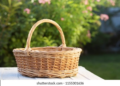Empty basket in the garden on the table