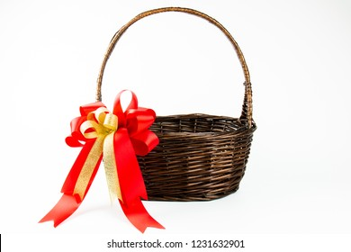 Empty basket item : red satin ribbon bow on brown basketry for Christmas and new year gift set