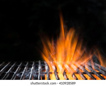 Empty BBQ Flaming Charcoal Cast Iron grill, close-up.
