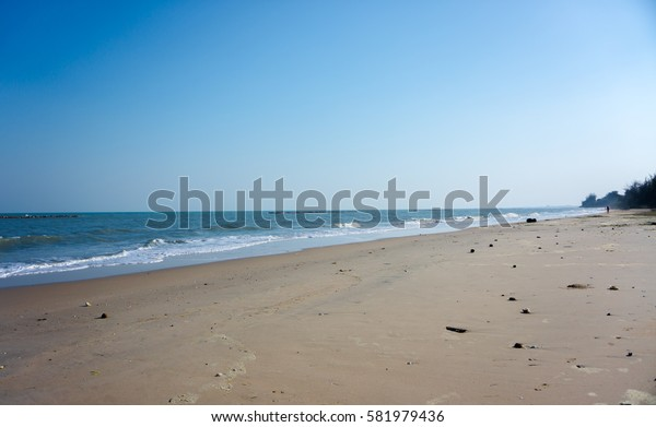 Empty beach with the blue sky