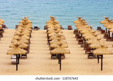 Empty beach with chairs and umbrellas