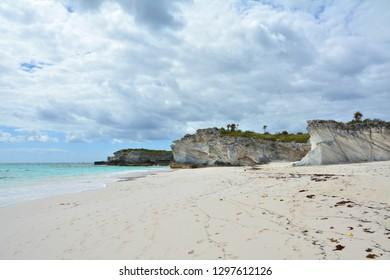Empty beach of Eleuthera island, Bahama. Sandstone rocks landscape.