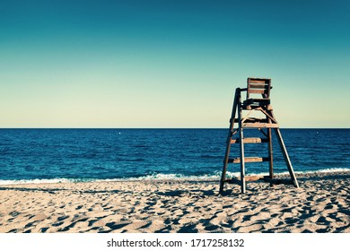 Empty beach with lifeguard seat at costa brava beach in spain