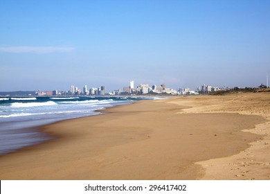 Empty beach at low tide in durban  with city skyline background