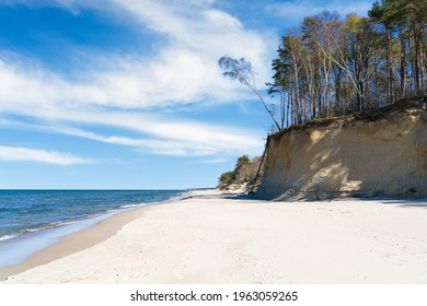 Empty beach on the Baltic Sea, dunes and high cliffs.