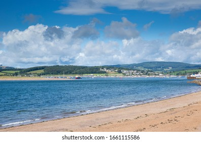 Empty beach and panoramic view on a beautiful summer day with blue sky in Exmouth in Devon, United Kingdom