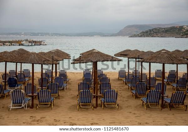 Empty Beach Sunbeds Umbrellas On Cloudy Stock Photo Edit