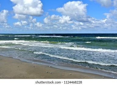 Empty beach, waves and dramatic sky at the Baltic sea shore line, Zelenogradsk, Kaliningrad region, Russia