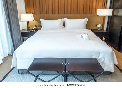 Empty bed in bedroom, rest, interior, comfort and bedding concept - bed at home bedroom