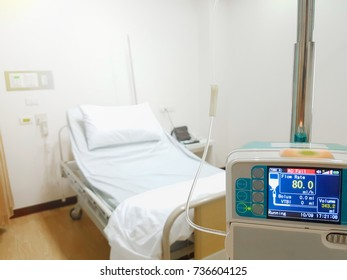 Empty Bed On Hospital Ward and IV tube infusion pump.