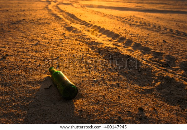 Empty Beer Bottle Sand Near Car Stock Photo (Edit Now) 400147945