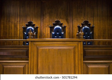 Empty bench with judge chairs in courtroom