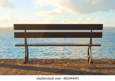 Empty bench and lake sight.