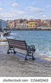 Empty bench on the Greek waterfront in Hania, Greece