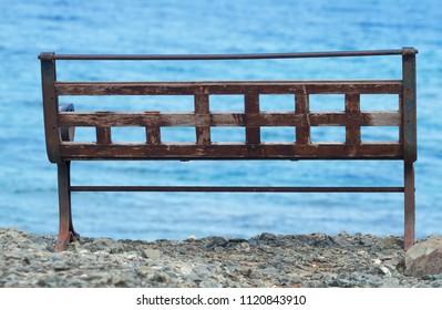 Empty bench on the Mediterranean Sea in Antalya, Phaselis.
