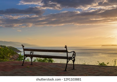 Empty bench on a seaside. Beautiful sunset on Adriatic coast in Croatia, Europe