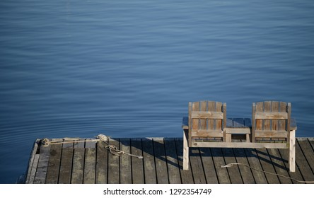 Empty bench overlooking the water in a calm and relaxing scene
