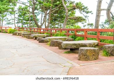 empty bench in park atJungmun Daepo Coast Jusangjeolli Cliff, Jeju Island, South Korea