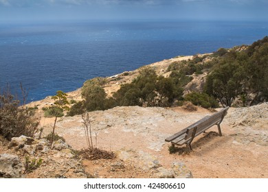 Empty bench with a sea view, Malta At the top of the Dingli Cliffs, wooden bench with a panoramic sea view. Mediterranean island Malta.