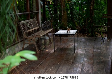 Empty bench with table in terrace house. Peaceful corner for a relaxing at holiday.