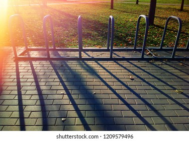 Empty bicycle parking stop with light leak background