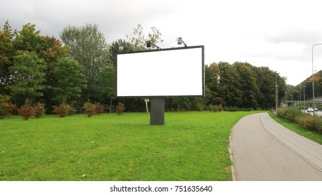 empty billboard by the road. green lawn