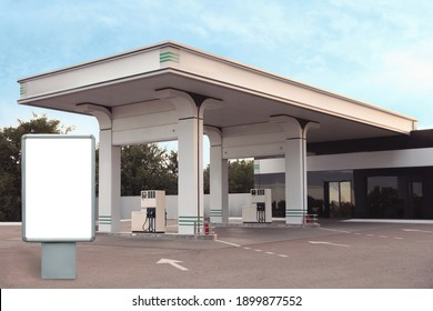 Empty billboard on modern gas station outdoors, space for design