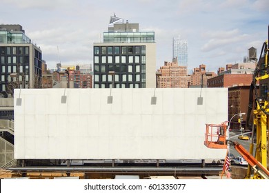 empty billboard sign with construction outside in New York City urban
