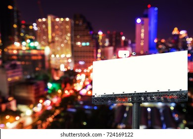 empty billboard stand in night cityscape bokeh background - can use to display or montage on product
