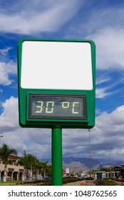 Empty billboard with thermometer which shows thirty degrees.