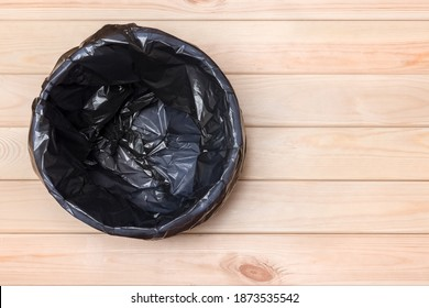 Empty Bin on Wooden Background. Trash Can Top View. Garbage Basket. Rubbish Black Bag in a Trash Can. Empty Rubbish Bin. Waste Can with Plastic Package. Empty Garbage Bin. Bin on Wooden Floor. Trash