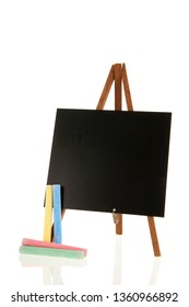 Empty black board with chalk isolated over white background