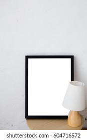 Empty black frame with place for text with lamp - Scandinavian hipster style room interior.