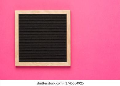 Empty black letterboard on pink background. Design mockup
