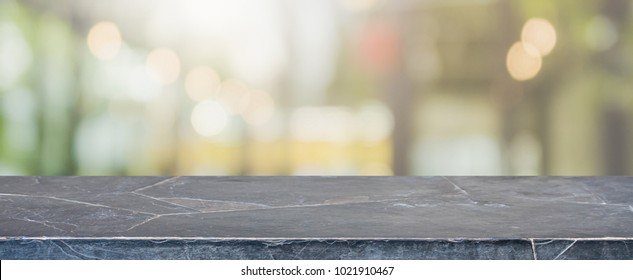 Empty black marble Stone table top and blurred restaurant interior banner background - can used for display or montage your products.