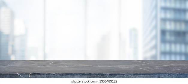 Empty black marble stone table top and blur glass window wall building banner mock up background - can used for display or montage your products.