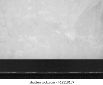 Empty black marble table top with grey concrete wall,Mock up for display or montage of product,use as background.