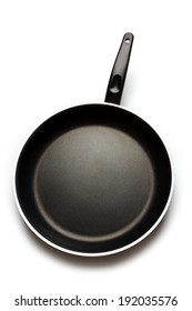 Empty black pan on isolated background