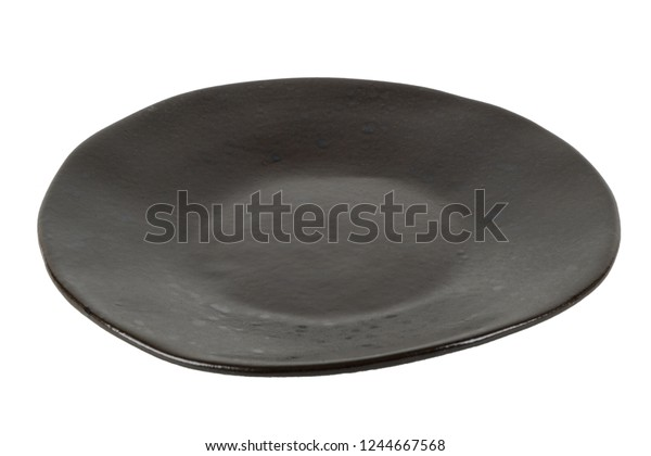 Empty black rustic plate isolated on white.